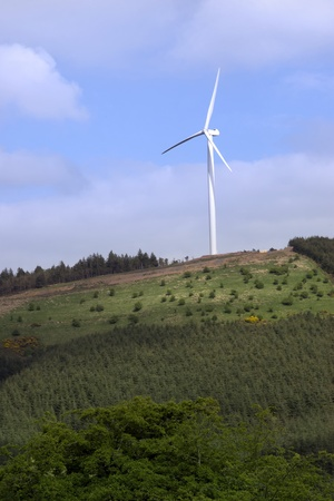 county tipperary: windmill on lush irish countryside landscape in glenough county tipperary ireland Stock Photo