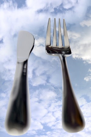 dining out: fork isolated against a cloudy background as in dining out