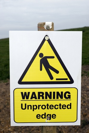steep cliff sign: a warning sign about an unprotected edge on a construction site with clipping path
