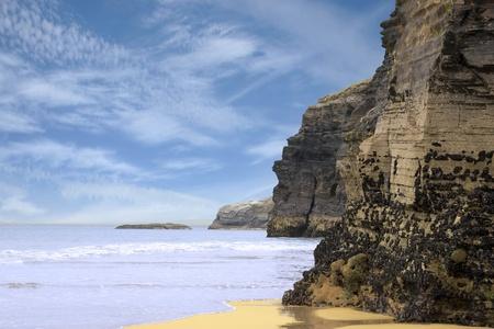 headland: ancient cliffs on the coastal beach in ballybunion county kerry ireland