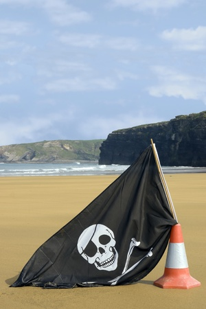 sandy golden beach with jolly roger flag in ballybunion county Kerry Ireland photo