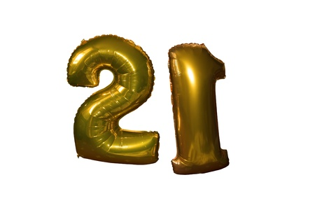gold helium filled 21st birthday balloons floating in the sky with clipping path photo