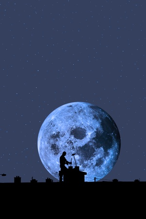 silhouette of a chimney sweep at work on the rooftop of a housing estate with moonlit sky in background