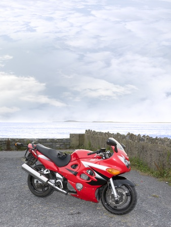 retro sports motorbike parked up in a scenic spot in ballybunion county kerry ireland photo