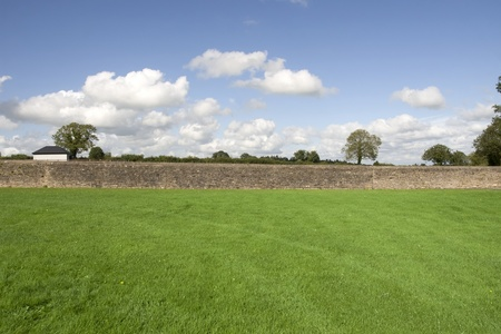 county tipperary: a scenic view of the green grass flields with stone walls in county tipperary ireland Stock Photo