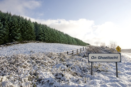 an ghaeltacht sign in snow scene in irish speaking area of county Kerry Ireland photo