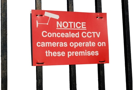 concealed cctv cameras in operation sign on white photo