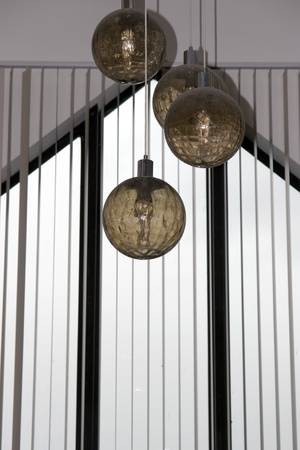 four hanging ball lights from a building roof Stock Photo - 13276733
