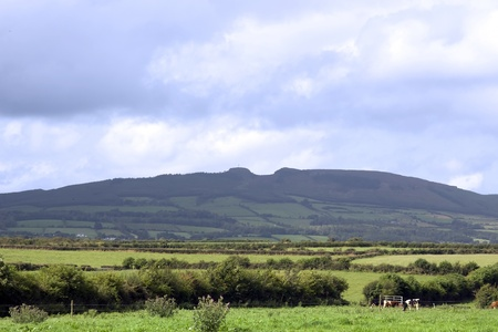 a scenic view of the devils bit and flields in county tipperary ireland photo
