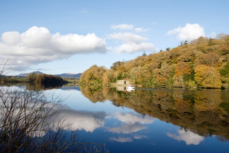 blackwater: boat cruising down the calm river blackwater in county Waterford Ireland