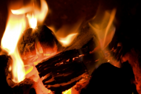 peat briquettes burning in a red hot fire