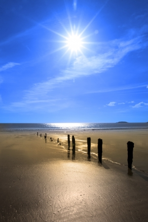 wave breakers at sunset on a golden beach in youghal county cork ireland Stock Photo - 15777039