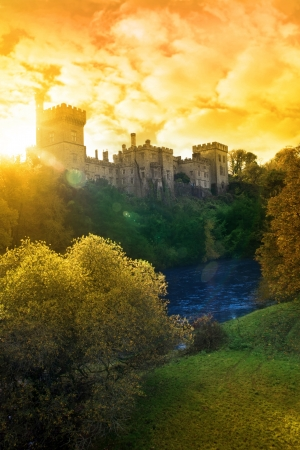 turrets: Lismore castle over looking the beautiful blackwater river in county Waterford Ireland on a autumn sunset evening