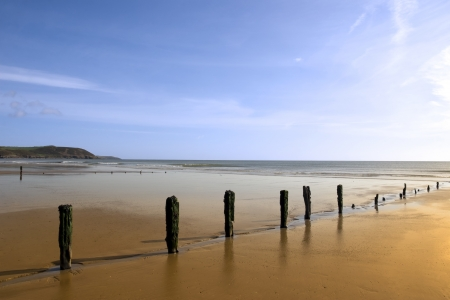 sunshine over the beach breakers in Youghal county Cork Ireland on a summers day Stock Photo - 16428145