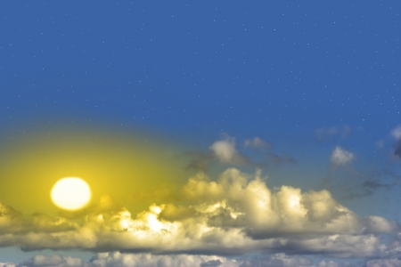 Beautiful yellow sun through clean white clouds with stars shining in the background photo