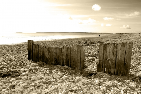 youghal: sepia beach breakers in Youghal county Cork Ireland on a summers day Stock Photo