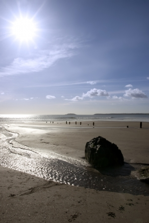 youghal: sunshine over the beach breakers in Youghal county Cork Ireland on a summers day Stock Photo