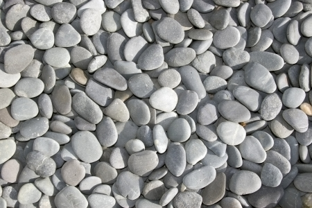 coastal erosion: many grey pebbles rounded from coastal erosion Stock Photo