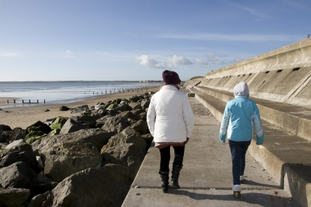youghal: mother and daughter strolling along the beach promenade in Youghal county Cork Ireland
