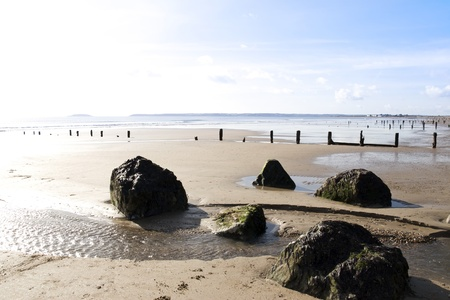 youghal: sunshine over the beach breakers in Youghal county Cork Ireland on a summers evening Stock Photo