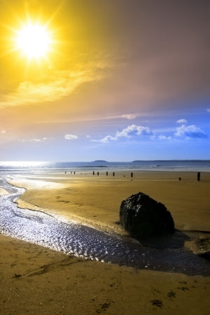 youghal: Beautiful yellow sun over the Youghal beach in Ireland on a summers day