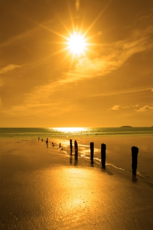golden sunshine over the beach breakers in Youghal county Cork Ireland on a summers day Stock Photo