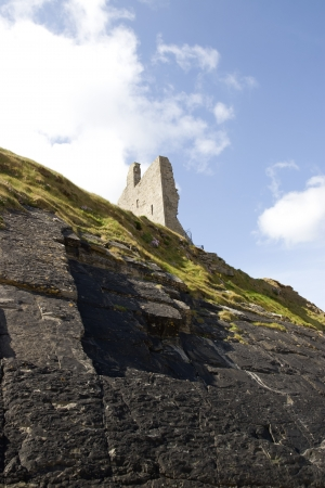 cliff face: cliff face view of castle ruins in Ballybunion county Kerry Ireland Editorial