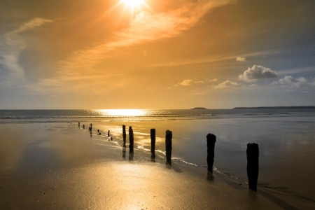 youghal: golden sunshine over the beach breakers in Youghal county Cork Ireland on a summers day Stock Photo