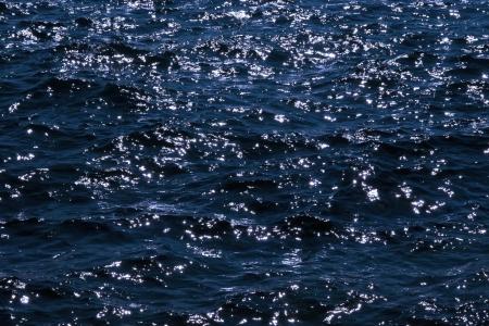 glistening: Atlantic ocean waves sparkling in the gentle soft waves