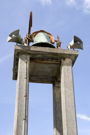 an old church bell against a blue sky in Ballybunion county Kerry Ireland photo