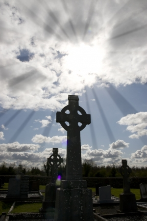 irish countryside: rays of light at an old ancient Celtic graveyard with unmarked gravestones in Ireland Stock Photo