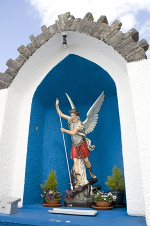 slaying: a statue of saint michael slaying the devil in county Kerry Ireland