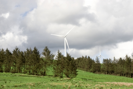 county tipperary: windmills on the hills of Glenough in county Tipperary Ireland with trees and fields in foreground  Stock Photo