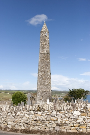 monastic sites: Ancient round tower and celtic graveyard with cathedral in Ardmore county Waterford, Ireland
