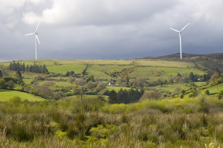 county tipperary: windmills on the hills of Glenough in county Tipperary Ireland with trees and fields in foreground