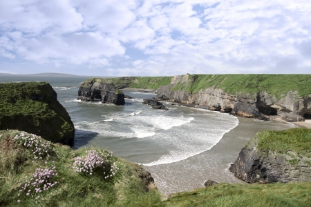 a view from the cliffs in Ballybunion county Kerry Ireland of the Virgin rock and coast photo