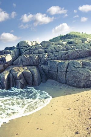 old natural rock formation on a coastal beach in county Donegal, Ireland photo