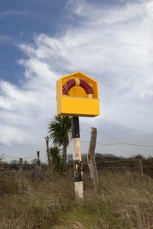 a life preserver ring on the county Kerry coastline in Ireland photo