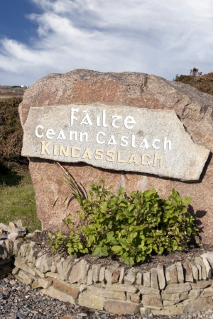village name sign on rock in Kincasslagh county Donegal Ireland photo