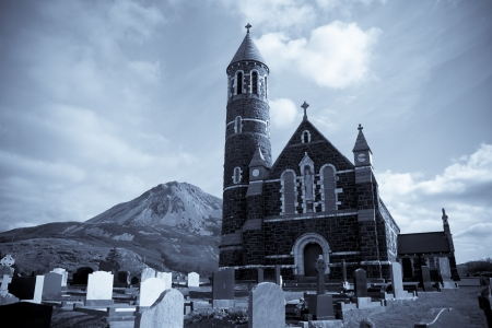 Church of the Sacred Heart, Dunlewey with Errigal mountains in Donegal Ireland blue toned photo