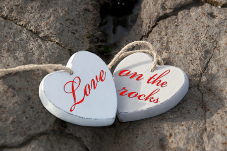 two wooden love hearts on the sand banks of an Irish beach in county Kerry photo