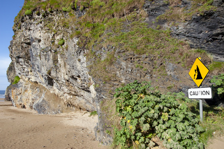 beware of cliff falls warning sign beside the cliffs in Ballybunion county Kerry Ireland photo