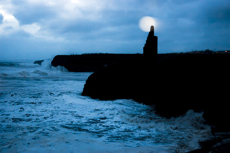 ballybunion: Ballybunion castle and cliffs during a very bad storm with crashing waves