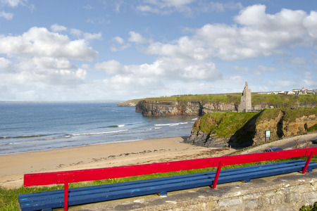 cliff edge: bench on a cliff edge  with views of Ballybunion beach cliffs and castle Stock Photo