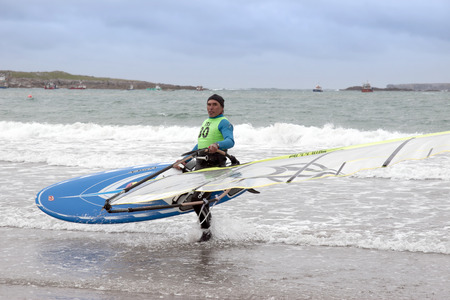 windsurfers: windsurfers getting ready to race and surf on the beach in the maharees county kerry ireland