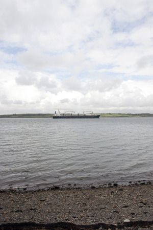 cargo ship with windmill parts on its journey through Youghal harbour county Cork Ireland photo