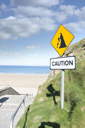 steep cliff sign: caution loose rocks or landslide sign in Ballybunion beach county Kerry Irelands wild atlantic way Stock Photo