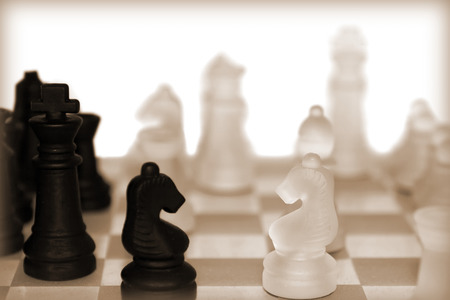 chess pieces in sepia isolated against a white background photo