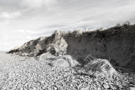 coastal erosion: dunes that have suffered extreme coastal erosion damage due to big storm waves Stock Photo