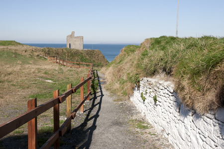 ballybunion: a beautiful fenced path to Ballybunion beach and castle Stock Photo